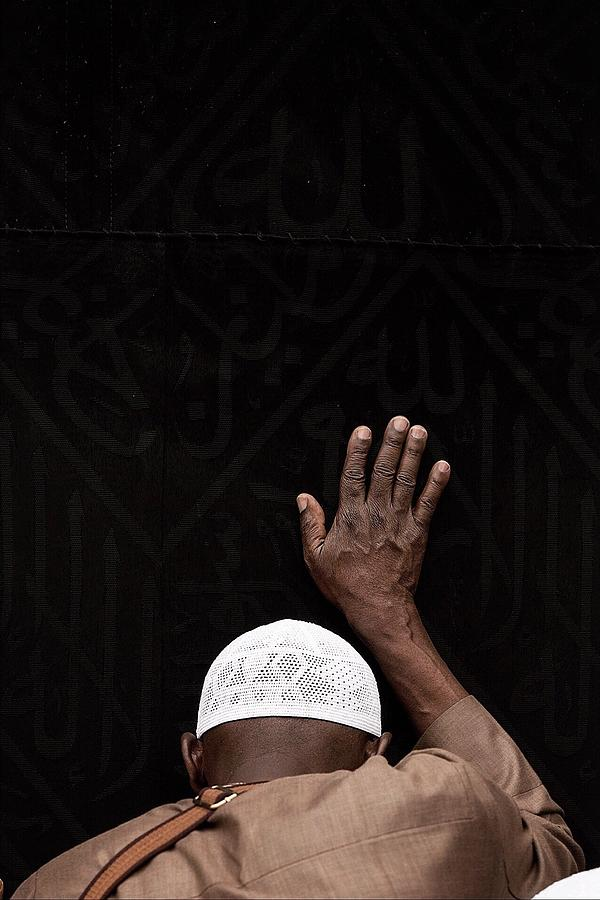 Rear View Of Muslim Man Touching Kaaba While Praying At Al-haram Mosque Photograph by Sami Alramyan / EyeEm
