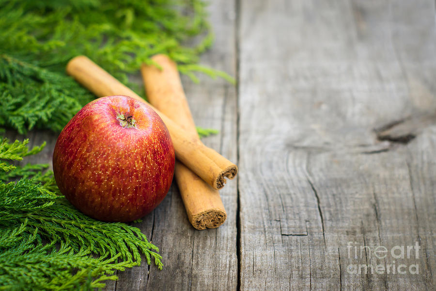 Apple Photograph - Red Apple With Cinnamon Sticks by Aged Pixel