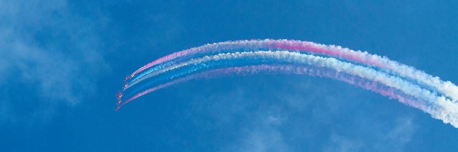 Panorama Photograph - Red Arrows Jets With White Smoke And Blue Sky Panorama by Charlesy