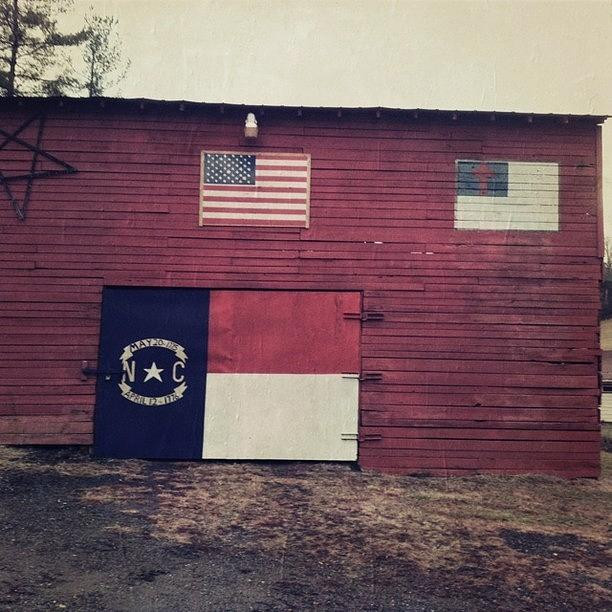 A Photograph - Red Barn With Painted Flags by Paul Cutright