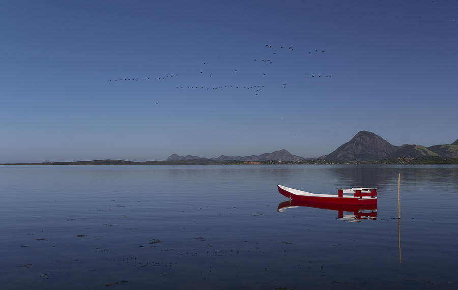 Red Boat In A Blue Lagoon Photograph