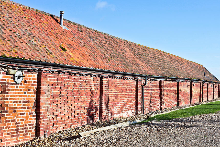 Aged Photograph - Red Brick Bard by Tom Gowanlock