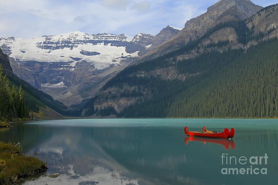 Canoe Photograph - Red Canoes On Lake Louise by Teresa Zieba