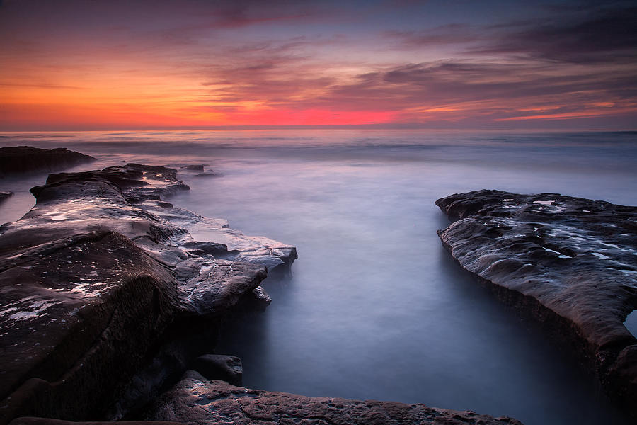 Beach Photograph - Red Dusk- Blue Water by Peter Tellone