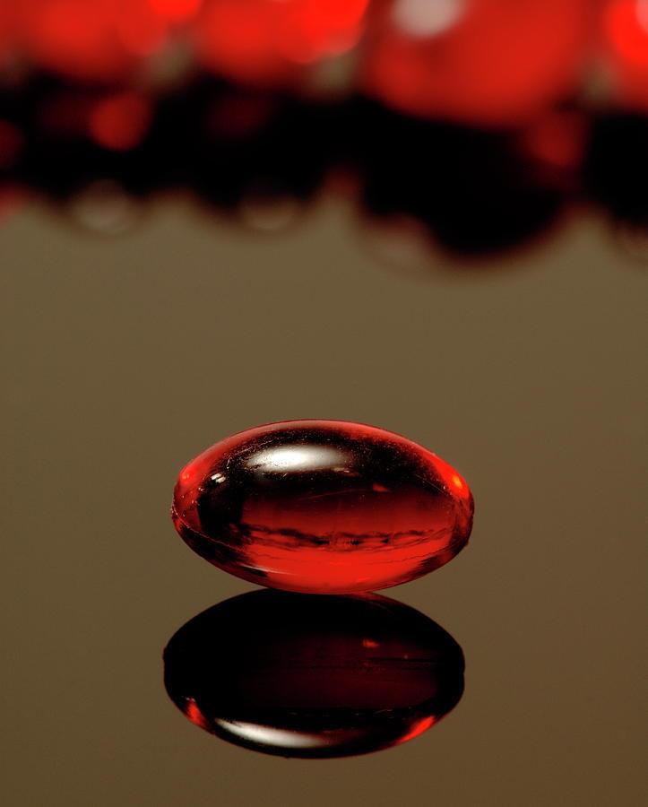 Nurofen Photograph - Red Nurofen Capsule by Paul Whitehill/science Photo Library