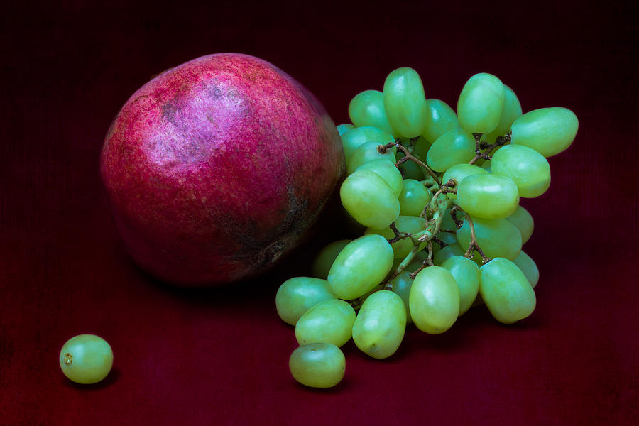 Pomegranate Photograph - Red Pomegranate And Green Grapes by Alexander Senin