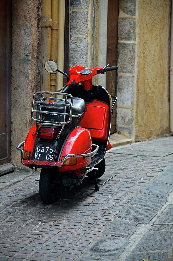 Red Vespa Scooter Parked In Sidestreet Photograph by Tony Burns