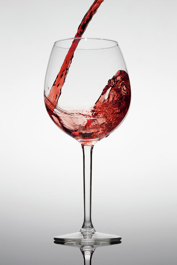 Red Wine Being Poured Into A Glass Photograph by Dual Dual