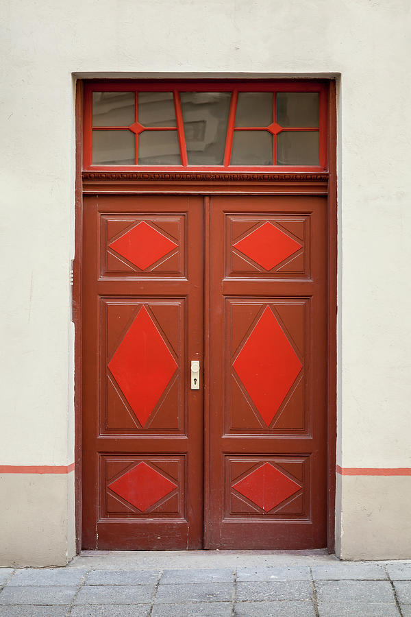 Red Wooden Door With Decoration Elements Photograph by Eugenesergeev