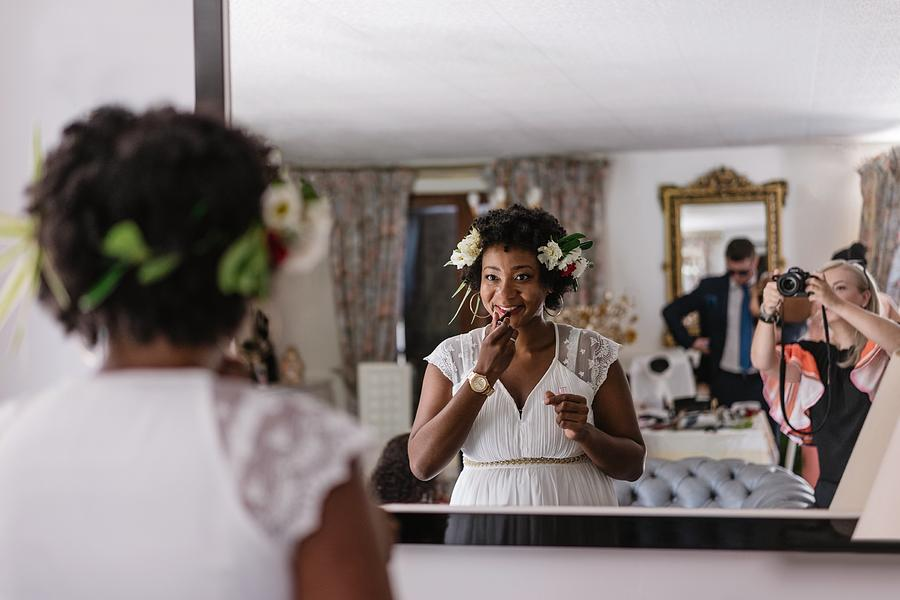 Reflection Of Bride Applying Lipstick While Standing In Front Of Mirror Photograph by Adriana Duduleanu / EyeEm