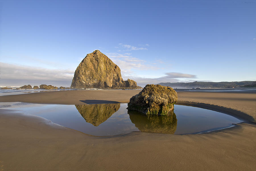 Haystack Rock Photograph - Reflection of Haystack Rock at Cannon Beach by David Gn
