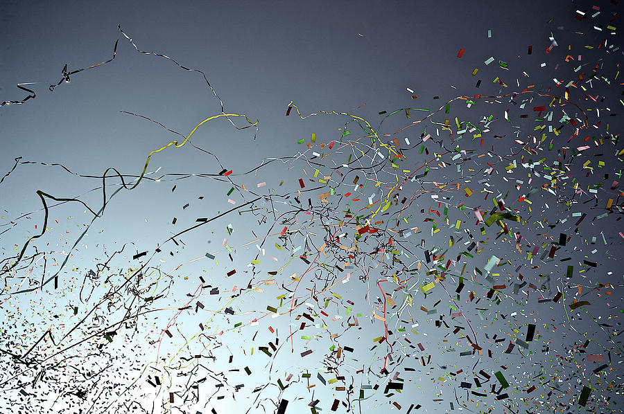 Release Of Confetti Under Blue Sky Photograph by Jeren (france)