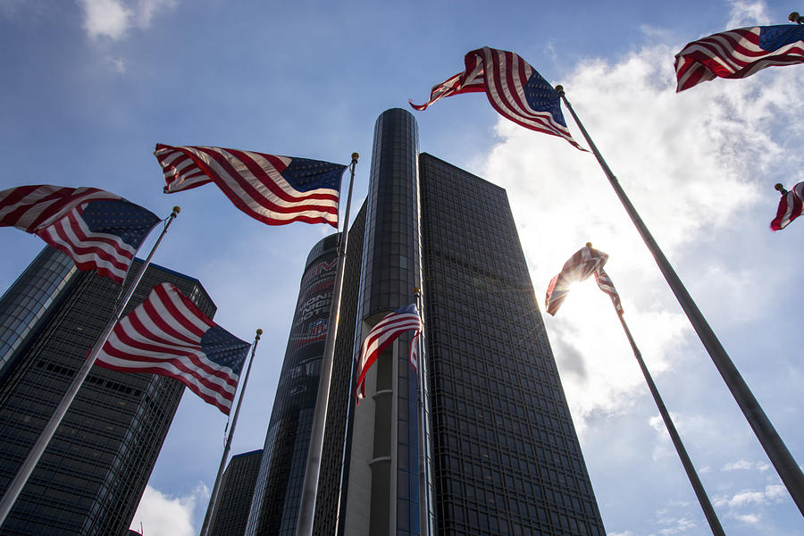 American Flag Photograph - American Flags And Renaissance Center by Gej Jones