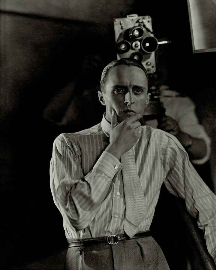 Rene Clair With A Camera Photograph by George Hoyningen-Huene