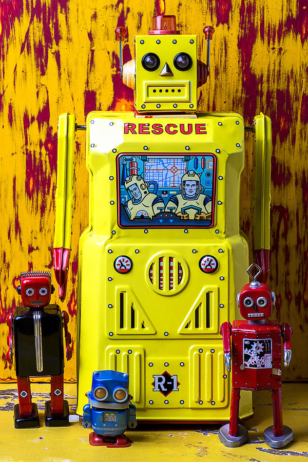 Yellow Photograph - Rescue Robot by Garry Gay