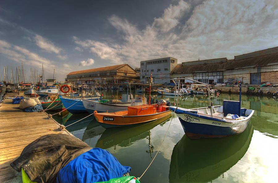 Israel Photograph - resting boats at the Jaffa port by Ron Shoshani