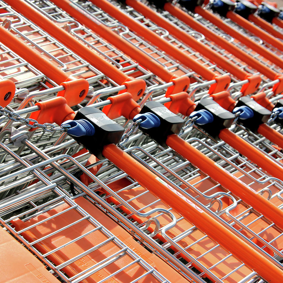 Retail Shopping Trolleys Photograph by Andrea Kennard Photography