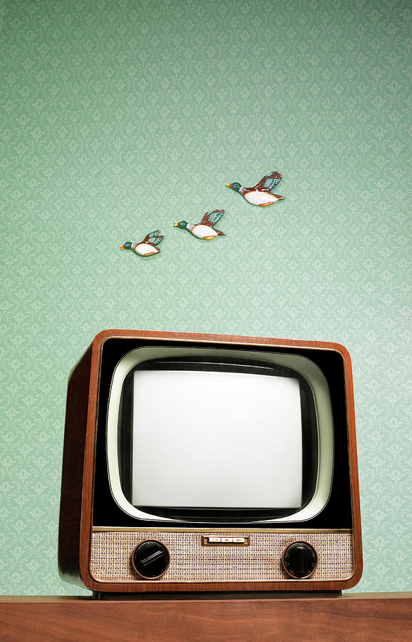 Retro Tv With Flying Ducks On The Wall Photograph by Peter Dazeley