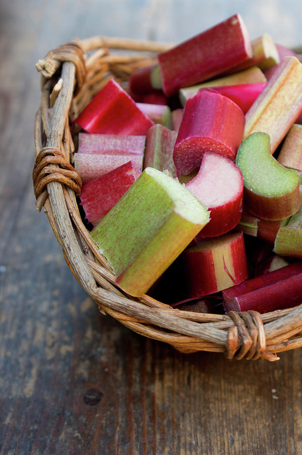Rhubarb In Wooden Basket, Close Up Photograph by Westend61