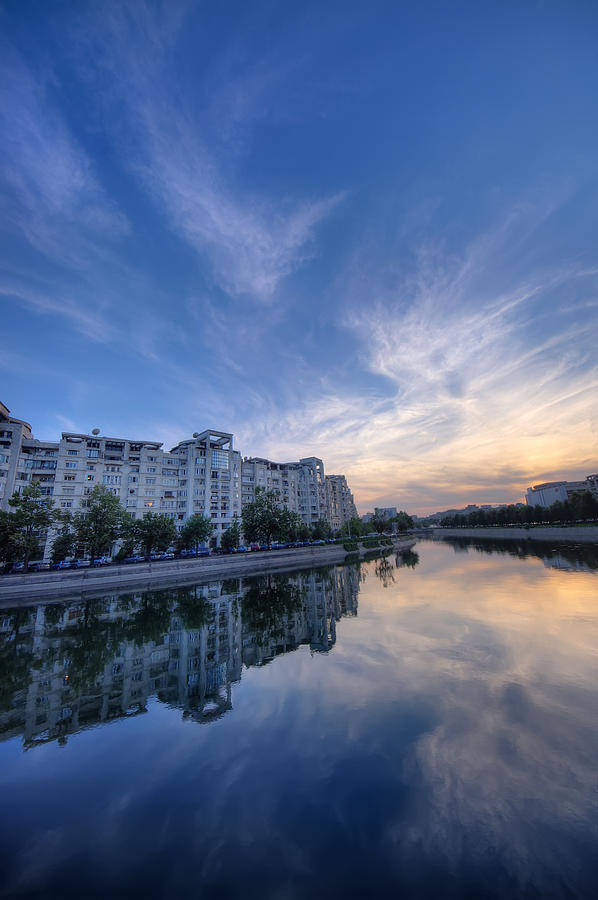 Bucharest Photograph - River In City At Sunset by Ioan Panaite