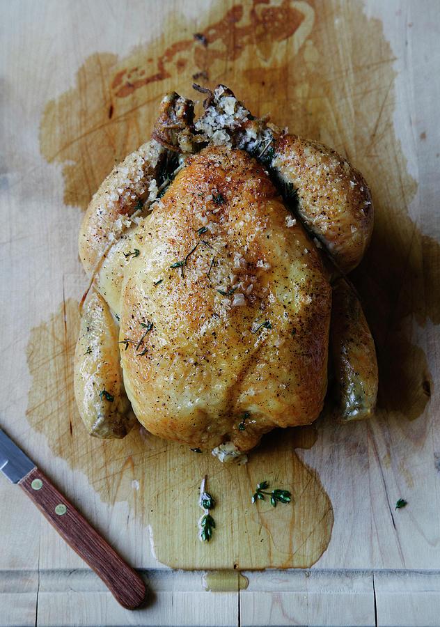 Roast Chicken On Cutting Board Photograph by Karen Beard