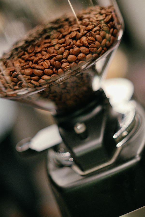 Roasted Coffee Beans In A Grinding Mill Photograph by Matthias Lambrecht