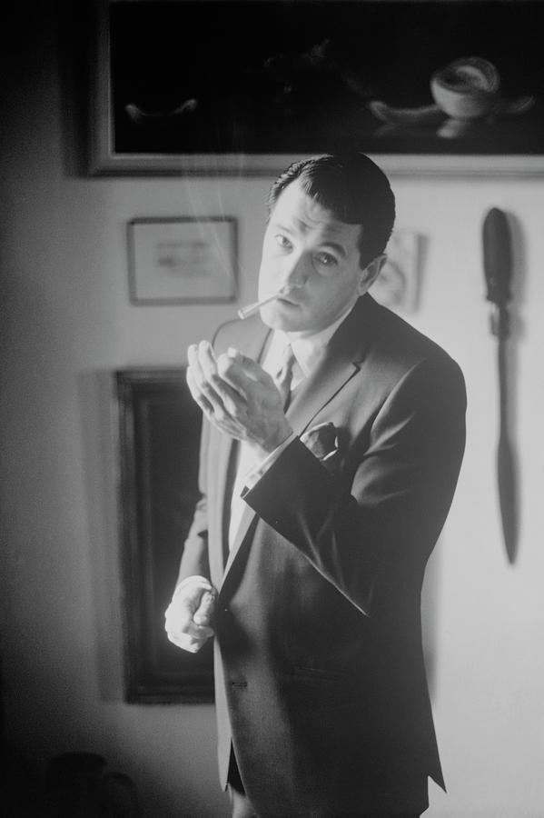 Rock Hudson Lighting A Cigarette Photograph by John Bryson