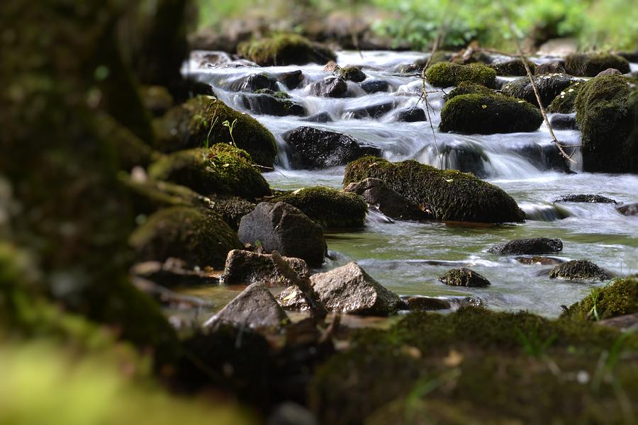 Distance Photograph - Rocks And The River by Dave Woodbridge