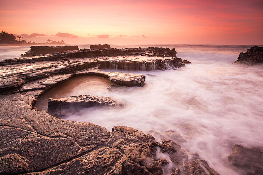 Rocky Hawaiian Shore With Pink Sunrise And Misty Water Photograph by Matthew James Quinton