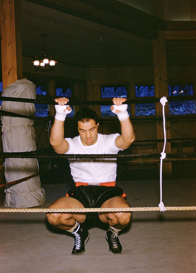 Marvin Newman Photograph - Rocky Marciano Stretching by Retro Images Archive