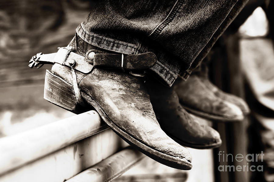 rodeo boots and spurs in black and white photograph by