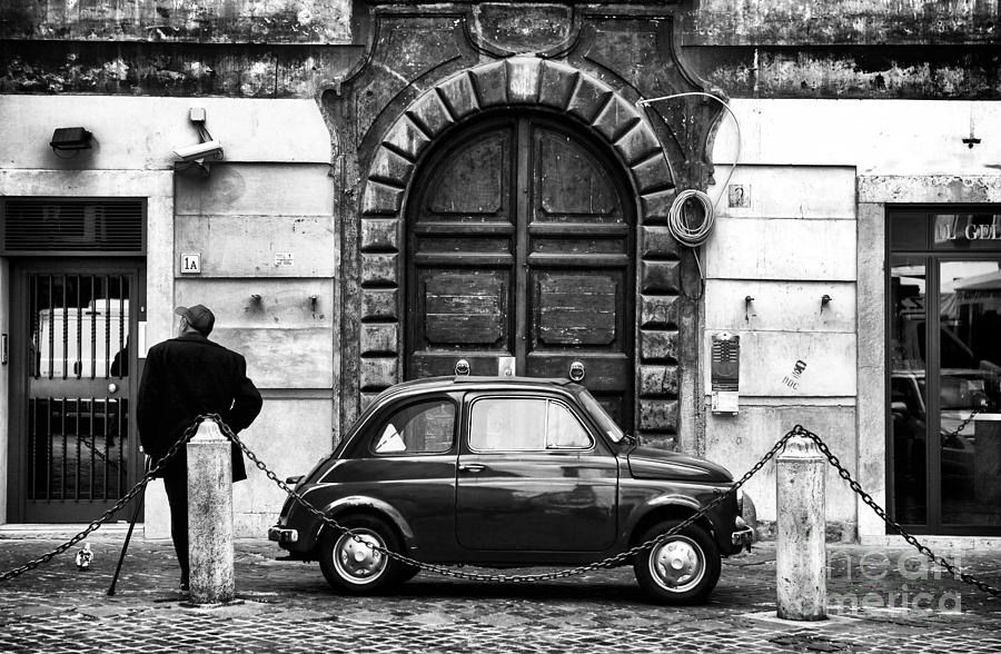 Man photograph roma streets in black and white by john rizzuto