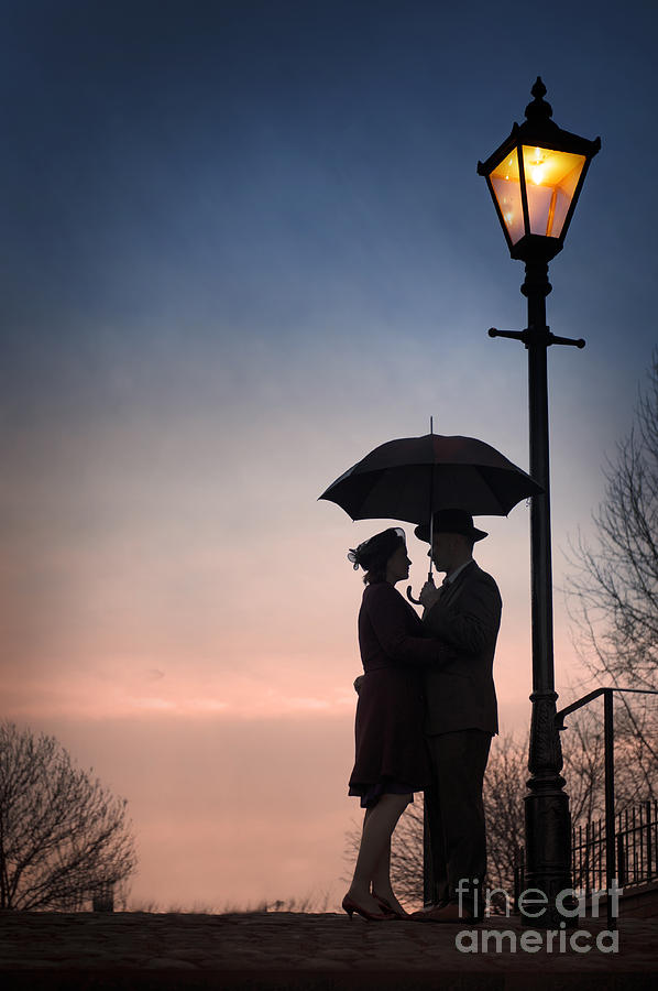 Romantic Couple Under A Street Lamp At Sunset Photograph
