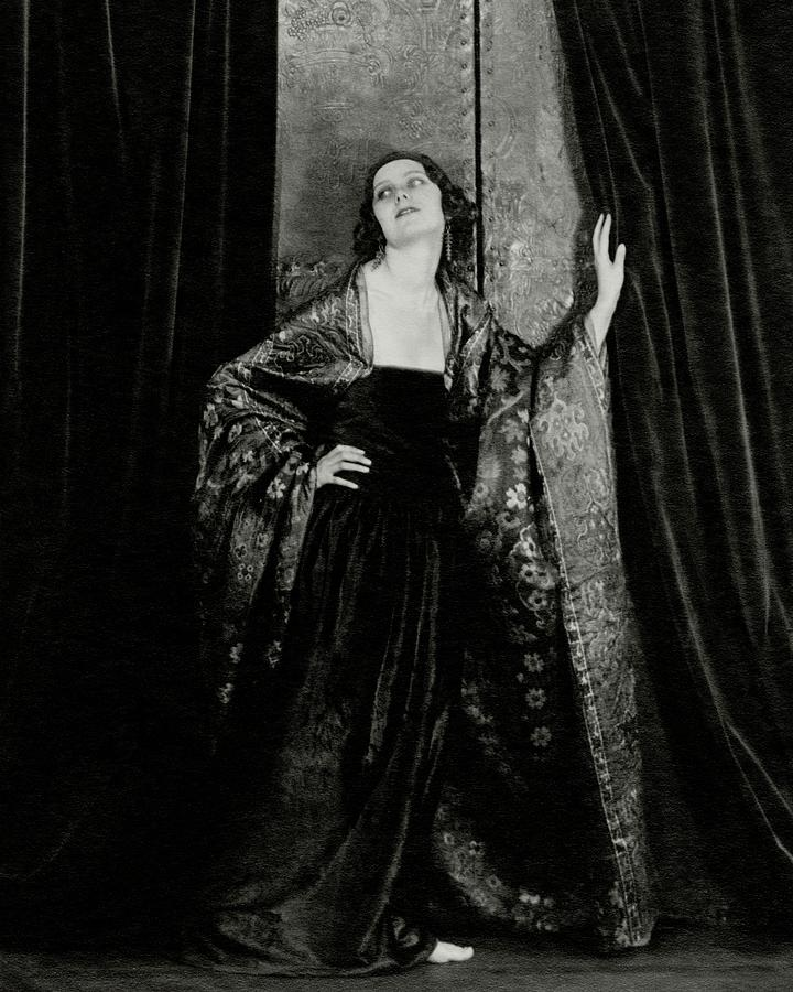 Rosalind Fuller Wearing A Dress And Cape Photograph by Francis Bruguiere