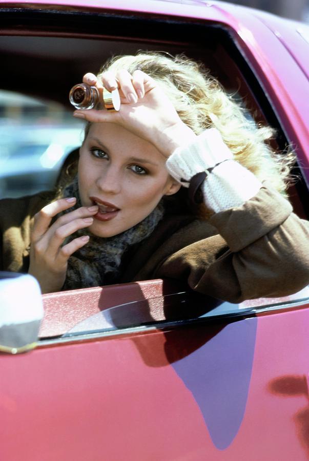 Rosie Vela Applying Lip Gloss Photograph by Arthur Elgort