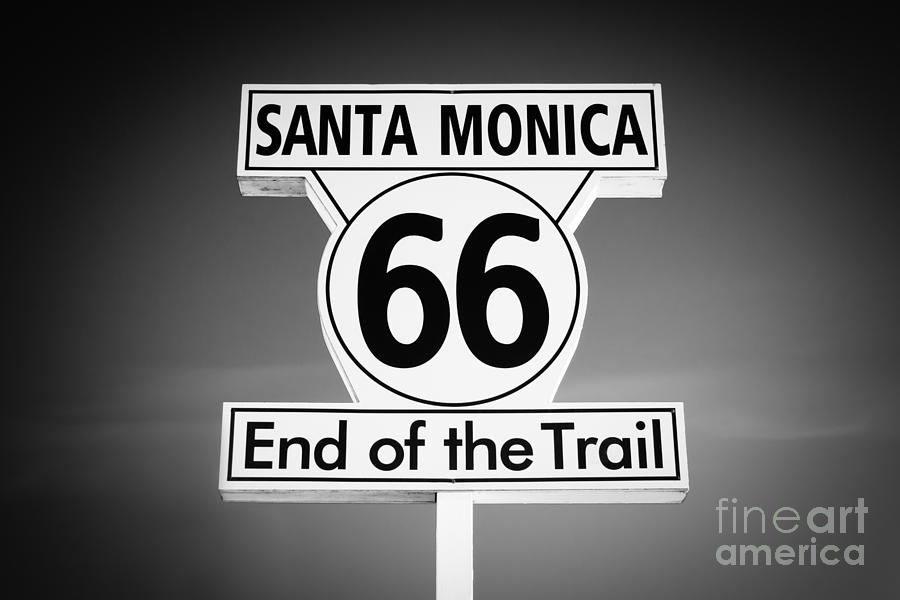 America Photograph - Route 66 Sign In Santa Monica In Black And White by Paul Velgos