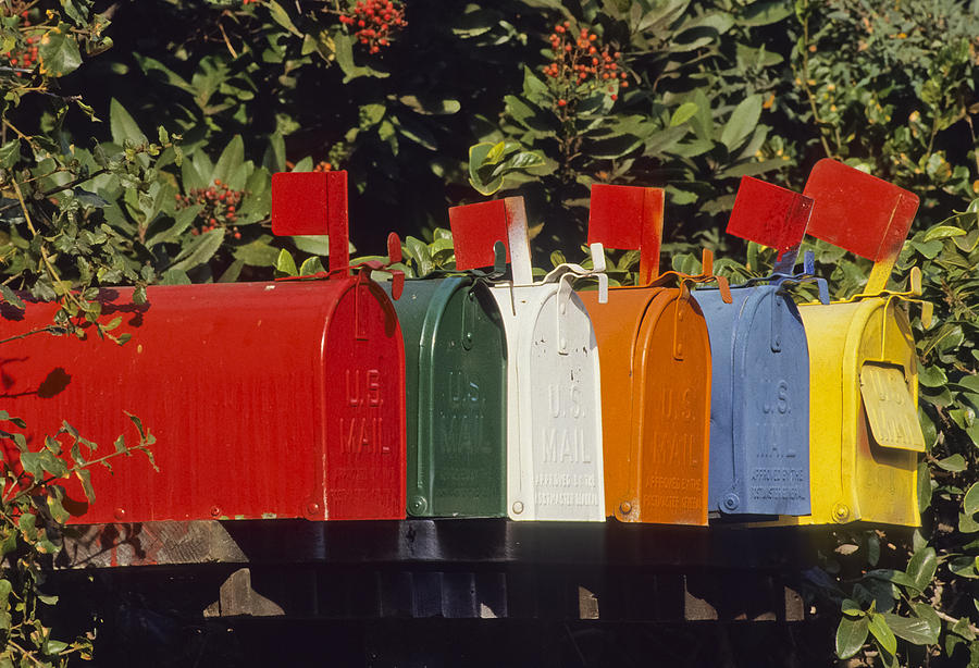 America Photograph - Row Of Colorful Mailboxes by David Litschel