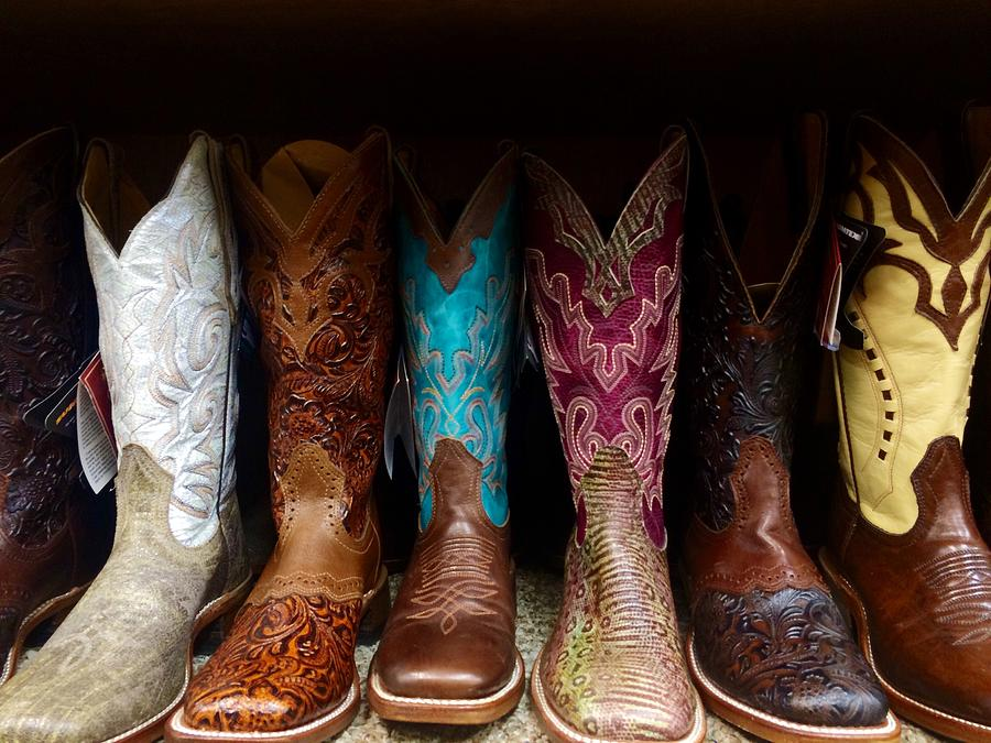Row Of Cowboy Boots On Shelf Photograph by Maggie Holguin / Eyeem