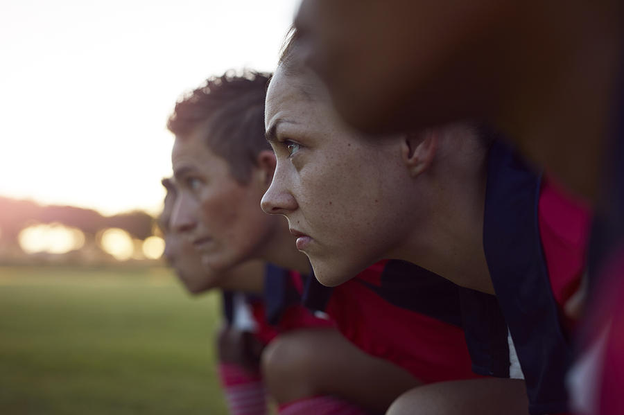 Row of female rugby players Photograph by Klaus Vedfelt
