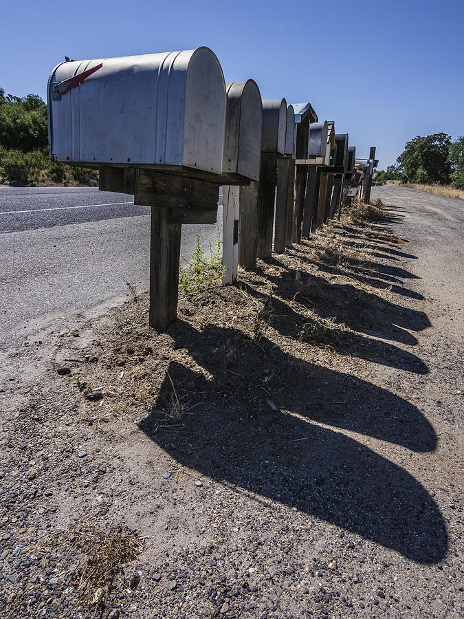 California Photograph - Row Of Mailboxes And Shadows by David Litschel