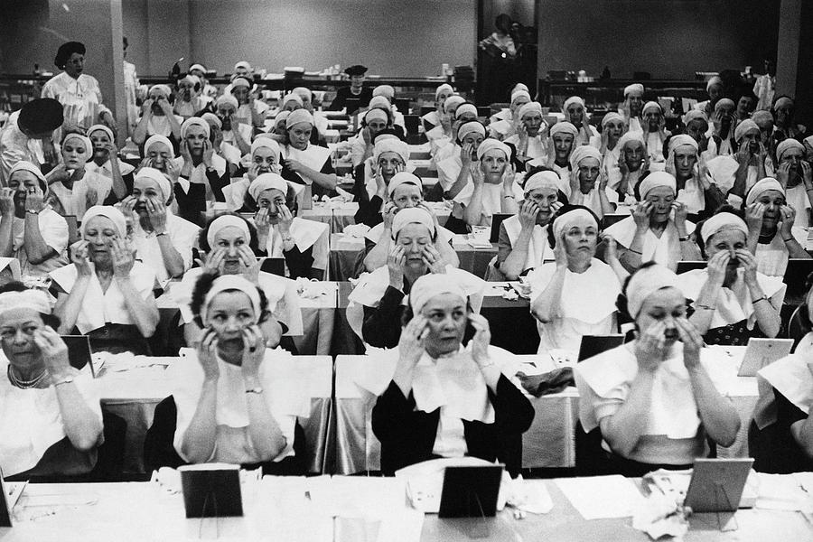 Rows Of Women Learning Facial Massage Photograph by Constantin Joffe