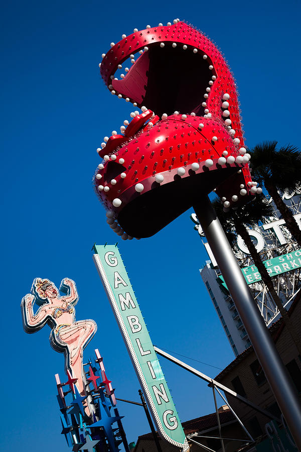 Color Image Photograph - Ruby Slipper Neon Sign In A City, El by Panoramic Images