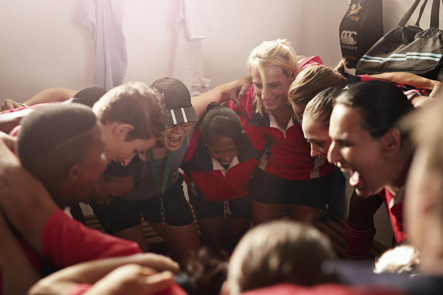 Rugby team shouting together before game Photograph by Klaus Vedfelt
