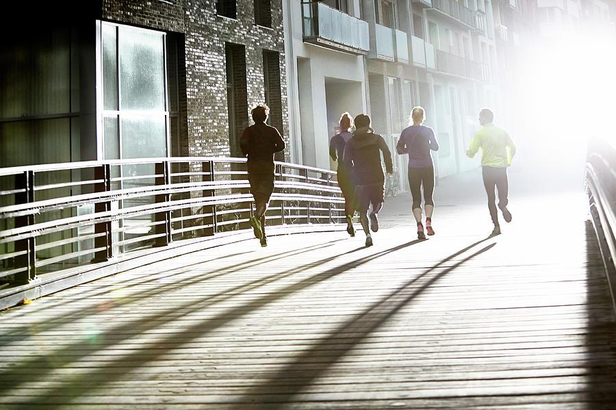 Runner In Urban Invironment Photograph by Henrik Sorensen