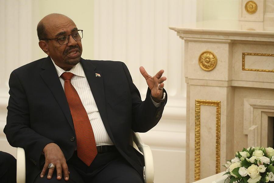 Russian President Vladimir Putin receives President of Sudan Omar al-Bashir at the Kremlin Photograph by Mikhail Svetlov