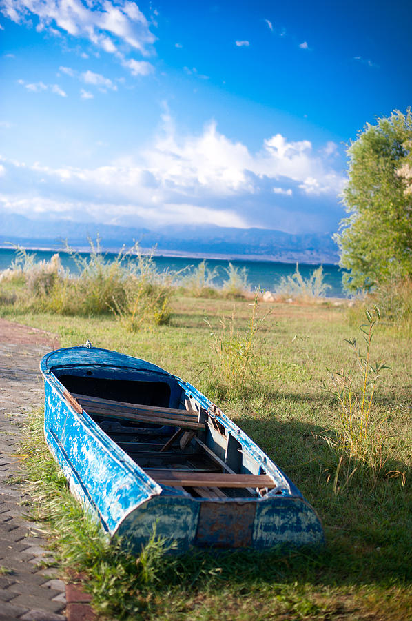 Lonely Photograph - Rusty Blue Boat by Sofia Walker