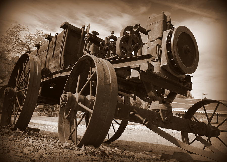 Farm Equipment Photograph - Rusty Pumper by Garrett Nyland