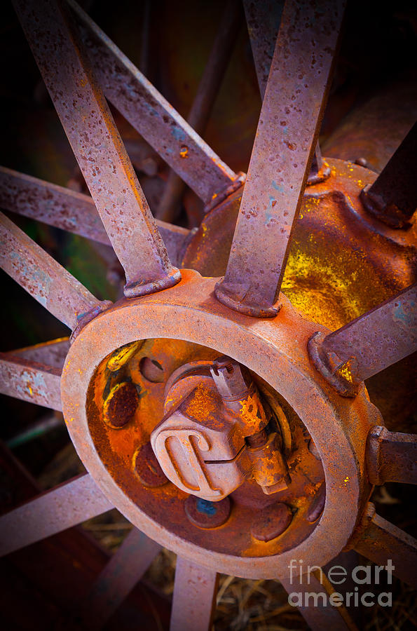 Agricultural Photograph - Rusty Spokes by Inge Johnsson