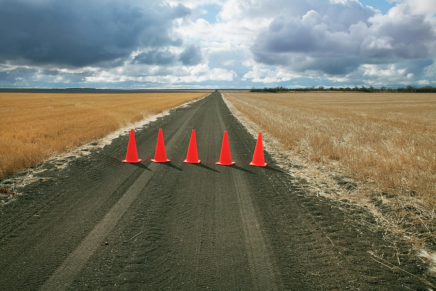 Safety Cones Lined Up Across A Rural Photograph by Benjamin Rondel / Design Pics