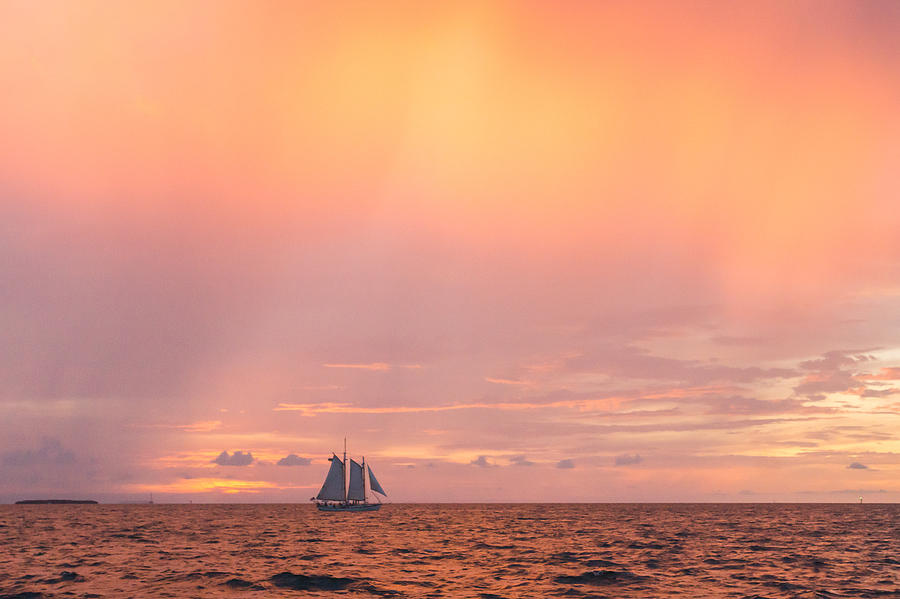 Sailboat at Sunset with Vast Orange Sky Key West Florida by Photographic Arts And Design Studio